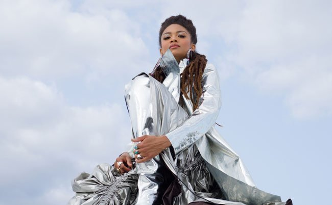 woman wearing a chrome suit